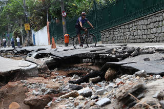 A damaged street is pictured after heavy rains in the Jardim Botanico neighbourhood in Rio de Janeiro