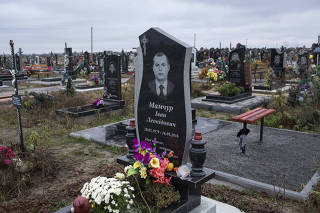 The headstone of Ivan Mamchur, a Ukrainian prison guard and veteran who was murdered in Rivne, a city in western Ukraine.