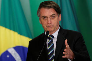 FILE PHOTO: FILE PHOTO: Brazil's President Jair Bolsonaro speaks during inauguration ceremony of the new Education Minister Abraham Weintraub at the Planalto Palace in Brasilia