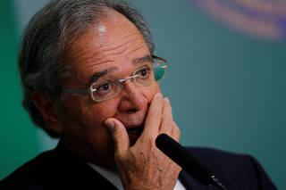 Brazil's Economy Minister Paulo Guedes reacts at a news conference in Brasilia
