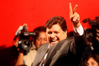 FILE PHOTO: Peruvian presidential candidate Garcia waves to his supporters in Lima