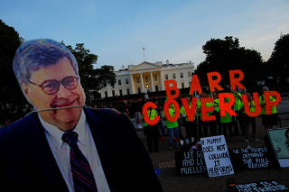 A cardboard cutout of U.S. Attorney General Barr is seen as protesters hold signs following the release of the Mueller report on U.S. President Trump at in Washington