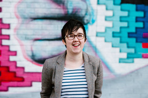 Journalist Lyra McKee smiles outside the Sunflower Pub on Union Street during a portrait session in Belfast, Northern Ireland May 19, 2017. Jess Lowe Photography/Handout via REUTERS ATTENTION EDITORS - THIS IMAGE WAS PROVIDED BY A THIRD PARTY. NO RESALES. NO ARCHIVES. MANDATORY CREDIT: JESS LOWE PHOTOGRAPHY ORG XMIT: LYRA03