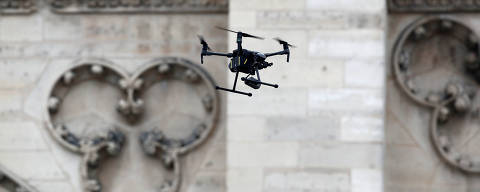 A drone is seen near Notre-Dame Cathedral after a massive fire devastated large parts of the gothic structure in Paris, France, April 16, 2019.  REUTERS/Benoit Tessier ORG XMIT: BTE73