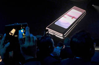 FILE PHOTO: The Samsung Galaxy Fold phone is shown on a screen at Samsung Electronics? Unpacked event in San Francisco