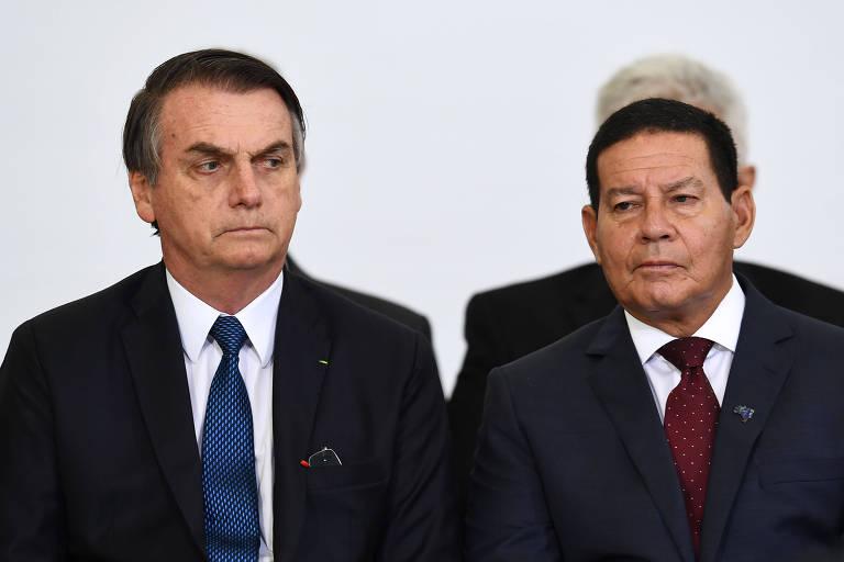 Jair Bolsonaro e Hamilton Mourão durante cerimônia de comemoração dos cem primeiros dias do governo, no Palácio do Planalto, neste mês