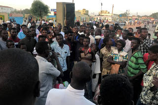 Sudanese demonstrators gather as they attend a mass anti-government protest at the Nyala market in South Darfur