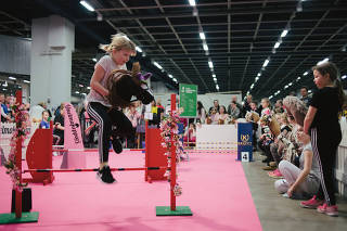 A girl competes during a hobbyhorse competition in Helsinki.
