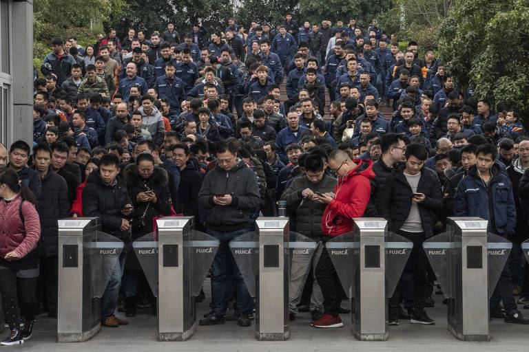 **EMBARGO: No electronic distribution, Web posting or street sales before Wednesday 3:00 a.m. ET Feb. 27, 2019. No exceptions for any reasons. EMBARGO set by source.** Workers leave the Changan Ford factory at the end of their shift in Chongqing, China, where an extensive subway network and heavy traffic are hindering car sales, Feb. 22, 2019. American automakers have bet billions on the China market and are now being hit by a slowdown. (Gilles Sabrié/The New York Times)