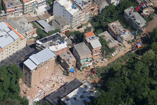 An aerial view of two collapsed buildings in Muzema community, Rio de Janeiro