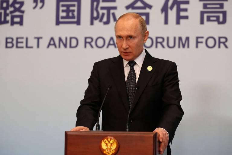 Presidente russo Vladimir Putin durante visita à China, neste sábado (27)