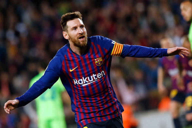 Messi comemora gol do título do Barcelona em jogo contra o Levante