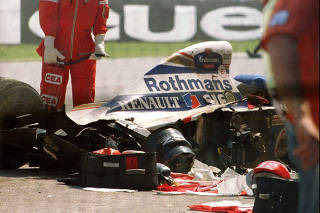 FILE PHOTO: Blood-stained medical equipment is seen surrounding Senna's Williams Renault car in Imola