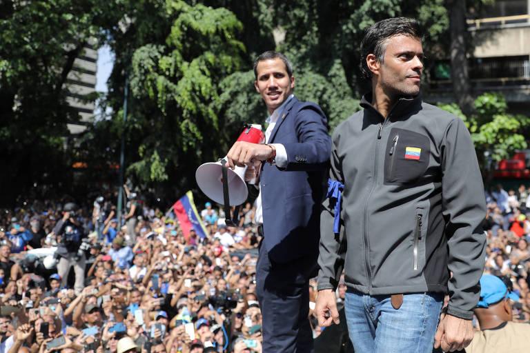 Os líderes oposicionistas Juan Guaidó, e Leopoldo López (dir.) participam de ato contra o regime de Nicolás Maduro