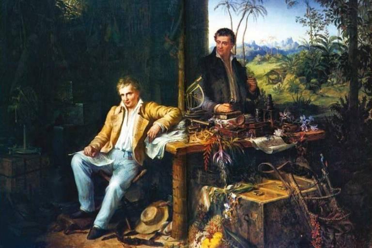Pintura a óleo; Humboldt está sentado, com o braço sobre a mesa; Bonpland está em pé, atrás da mesa