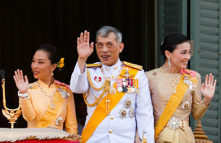 Thailand's newly crowned King Maha Vajiralongkorn, Queen Suthida and Princess Bajrakitiyabha are seen at the balcony of Suddhaisavarya Prasad Hall at the Grand Palace where King grants a public audience to receive the good wishes of the people in Bangkok