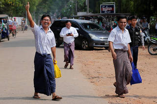 Reuters reporters Wa Lone and Kyaw Soe Oo gesture as they walk free outside Insein prison after receiving a presidential pardon in Yangon