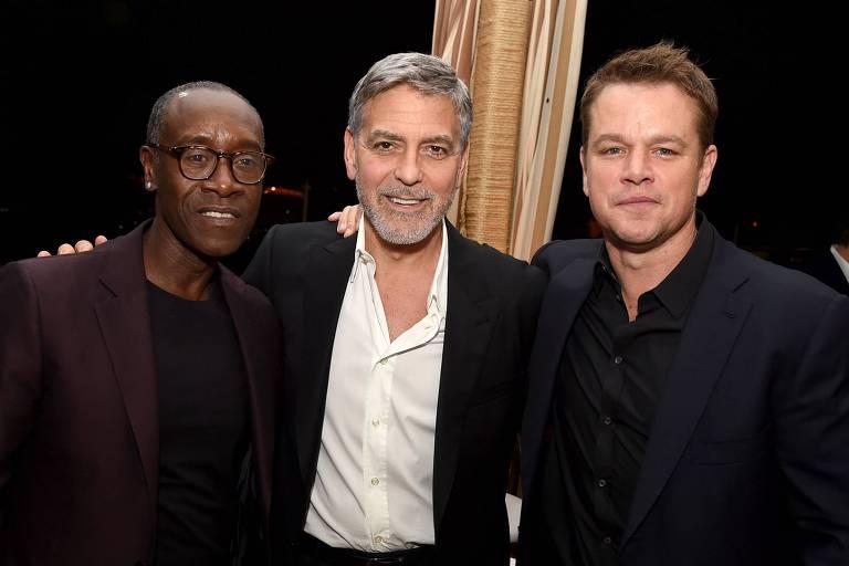 Da esq. para dir., Don Cheadle, George Clooney e Matt Damon