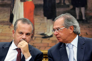 Brazil's Secretary of Social Security Rogerio Marinho talks with Brazil's Economy Minister Paulo Guedes during a session of the commission of the pension reform bill at the National Congress in Brasilia