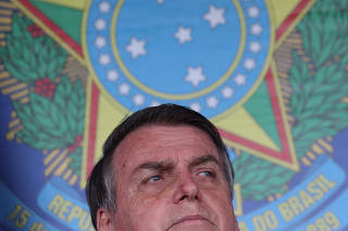 Brazilian President Jair Bolsonaro talks with media after attending a ceremony to celebrate the Victory Day marking the Allied Forces' victory in World War Two in Rio de Janeiro