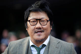 Cast member Benedict Wong poses on the red carpet at the world premiere of the film