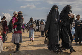 Women and children who fled the Islamic State in the foreigners section at the Kurdish-controlled al-Hol camp in northern Syria.