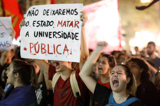 Students and university professors protest against Brazil's President Jair Bolsonaro in Curitiba