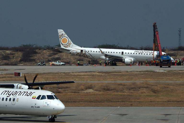 Aeronave da Embraer, operada pela Myanmar National Airlines, após pouso de emergência no aeroporto internacional Mandalay