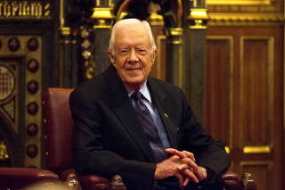 FILE PHOTO: Former U.S. President Jimmy Carter sits after delivering a lecture at the House of Lords in London