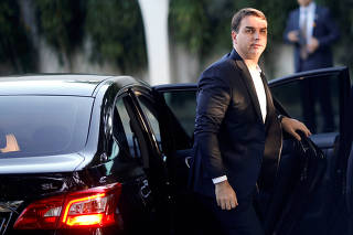 Brazilian Senator Flavio Bolsonaro arrives for a meeting at the Senate President's home in Brasilia