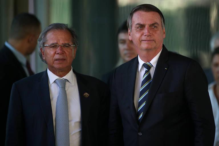 Paulo Guedes, ministro da Economia, ao lado do presidente Jair Bolsonaro
