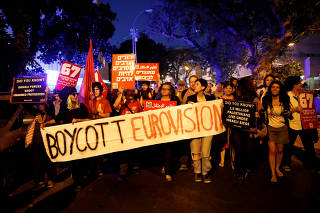 FILE PHOTO: Protesters hold banners and placards as they take part in a demonstration calling for an end to Israel's policy towards Gaza and a boycott of the 2019 Eurovision Song Contest as the first semi final of the contest begins in Tel Aviv, Israel