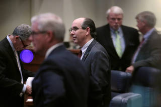 Senator Clyde Chambliss (R) is seen with other senators during a state Senate vote on the strictest anti-abortionbill in the United States at the Alabama Legislature in Montgomery