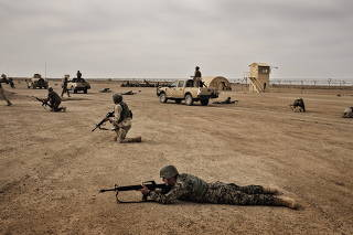 Afghan National Army soldiers train under American supervision at Camp Bastion in Afghanistan's Helmand Province.