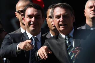 Brazilian President Jair Bolsonaro and his son and Senator Flavio Bolsonaro attend a ceremony to celebrate the 130th anniversary of the Military School in Rio de Janeiro