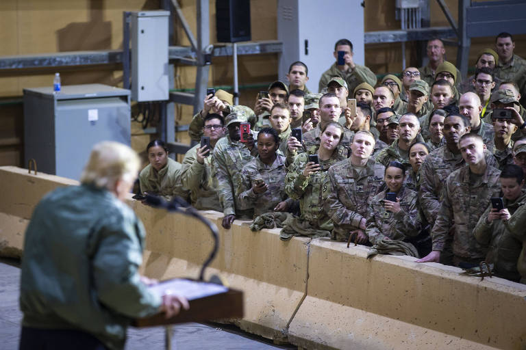 FILE -- President Donald Trump addresses troops during a surprise visit to at Al Asad Air Base in Iraq, Dec. 26, 2018. Amid repeated, unsubstantiated statements from the Trump administration that Iran and aligned militias were planning to strike American troops in the region, most Iraqis insist that the prospect of a full-blown war is remote. (Al Drago/The New York Times)