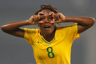 FILE PHOTO: Brazil's Formiga celebrates her goal against Germany during their women's semi-final soccer match in Shanghai Stadium at the Beijing 2008 Olympic Games