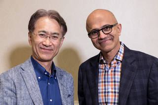 Kenichiro Yoshida President and CEO Sony Corporation and Satya Nadella CEO Microsoft Corporation