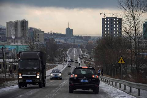 This photo taken on November 21, 2017 shows a general view of traffic and the skyline of North Korea's northeastern city of Rason, near the borders of both China and Russia. - North Korean leader Kim Jong Un and Russia's leader Vladimir Putin are expected to meet in the eastern Russian port of Vladivostok, possibly on April 24 or 25, 2019, in the first summit between the leaders of North Korea and Russia since Kim Jong Il met with Dmitry Medvedev eight years ago. (Photo by Ed JONES / AFP) / TO GO WITH NKorea-Russia-diplomacy-economy,FOCUS by Claire LEE
