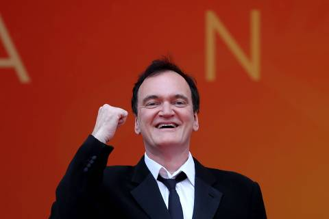 TOPSHOT - US film director Quentin Tarantino poses as he arrives for the screening of the film