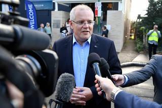 Australian Prime Minister Morrison speaks to the media as he arrives at the Horizon Church in Sutherland