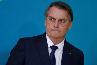 Brazil's President Jair Bolsonaro attends a ceremony for the presentation of the 2nd phase of the advertising campaign of the pension reform bill at the Planalto Palace in Brasilia