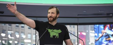 (FILES) In this file photo taken on May 2, 2019, Beyond Meat CEO Ethan Brown speaks before ringing the opening bell at Nasdaq MarketSite in New York City. - The celebrity-backed vegan burger start-up Beyond Meat made a sizzling Wall Street debut May 2, more than doubling its share price, as investors show an appetite for the growing trend in plant-based diets. Having priced its shares at $25, Beyond Meat began trading at $46 but soon sky-rocketed, ending at $65.75 per share -- a valuation of $3.8 billion. Tuesday morning the share bounced further to $68.11, lifting the valuation close to $4 billion. (Photo by Drew Angerer / GETTY IMAGES NORTH AMERICA / AFP)