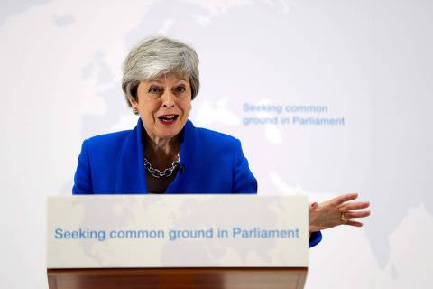 Britain's Prime Minister Theresa May delivers a speech in central London on May 21, 2019. - British Prime Minister Theresa May on Tuesday outlined a series of incentives for MPs to support her Brexit deal, saying there was