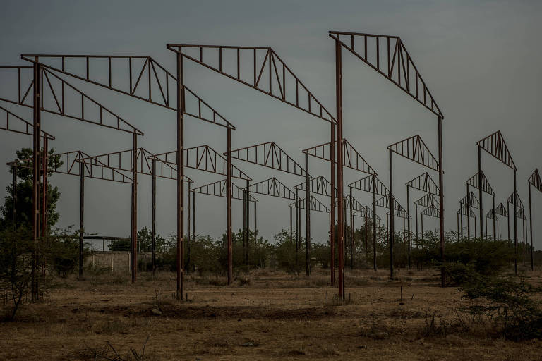 Unfinished warehouses that the government started to build as part of a socialist work program, in Maracaibo, Venezuela, May 6, 2019. As the country?s has economy plummeted, armed gangs have taken control of entire towns, public services have collapsed and the purchasing power of most Venezuelans has been reduced to a couple of kilograms of flour a month. (Meridith Kohut/The New York Times)