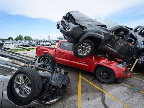 JEFFERSON CITY, MO - MAY 23: Trucks are piled on top of each other at Riley Auto Group on May 23, 2019 in Jefferson City, Missouri, after a tornado struck there. A series of powerful tornadoes killed at least three people in southwestern Missouri causing extensive damage in Jefferson City, the state capital.   Reed Hoffmann/Getty Images/AFP == FOR NEWSPAPERS, INTERNET, TELCOS & TELEVISION USE ONLY ==