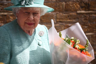 Britain's Queen Elizabeth visits a replica of one of the original Sainsbury's stores in London