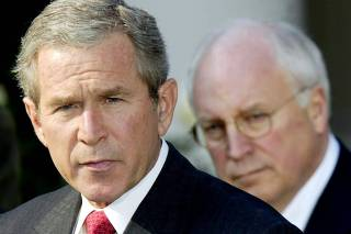 PRESIDENT BUSH SPEAKS AS VICE PRESIDENT CHENEY LOOKS ON DURING SIGNING