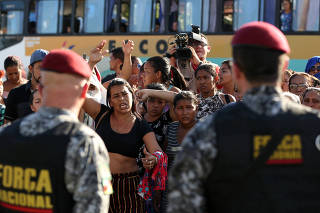 Relatives of inmates react in front of a prison complex in the Brazilian state of Amazonas after prisoners were found strangled to death in four separate jails, according to the penitentiary department in Manaus