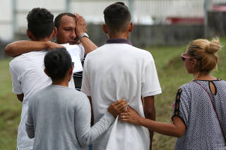 Relatives of inmates react at the Institute of Forensic Science in Manaus
